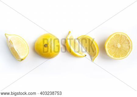 Isolated Lemons. Collection Of Whole And Sliced Lemons Isolated On White Background