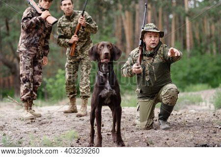 Wildfowl Hunting Excited Man With Rifle And Dog.