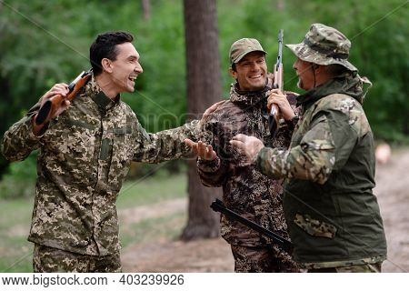 Happy Hunters 30S Guys And Old Man Talk And Laugh.
