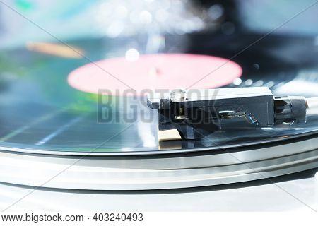 Vinyl record player, bright lights disco-bokeh.