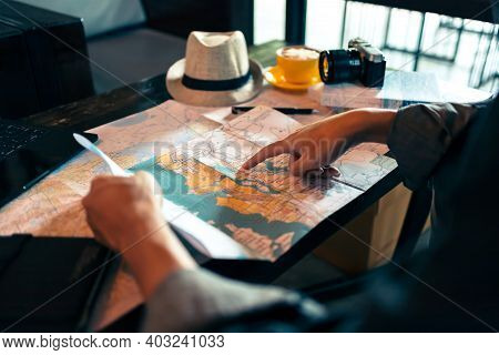 Tourist Planning Vacation With Map And Other Travel Accessories On The Table. Travel, Holiday, Vocat
