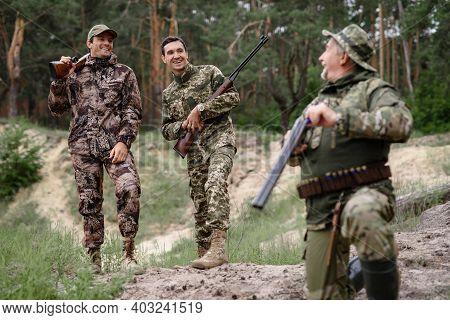 Excited Happy Hunters Laugh Recharging Shotgun.