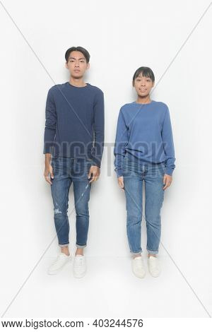 Loving couple posing on a white background. Relationship concept.