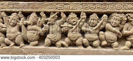 Hindu God deity statue. Ancient sandstone carved historical Hindu God sculptures in the temple walls