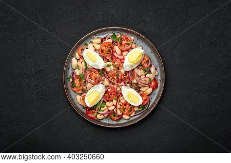 A Piyaz Salad On Black Plate On Dark Slate Table Top. Turkish Cuisine Vegetarian Dish. Middle Easter