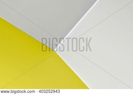 Abstract Graphic Background In Yellow And Gray Colors. Straight Lines On The Wall, Corner With Three