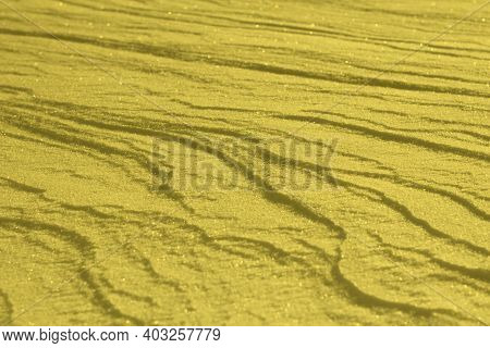 Trendy Color Of The Year 2021 Illuminating Yellow. Snowy White Background. The Texture Of The Snow.
