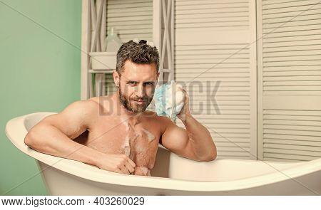 Hygiene And Health. Morning Shower. Man Wash Muscular Body With Foam Sponge. Macho Man Washing In Ba