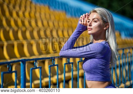 Dedicated To Fitness. Healthy And Sporty. Sexy Fitness Woman In Sportswear. Athletic Relax At Stadiu