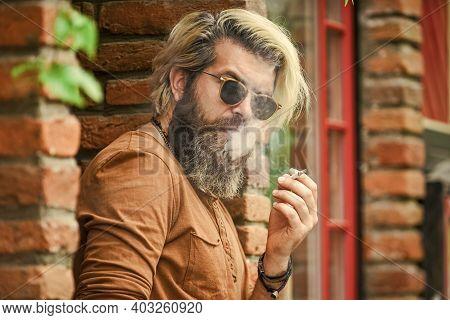 Smoking Outdoors. Went On Smoke Break. Hipster Smoking Old Architecture Background. Smoking Habit. F