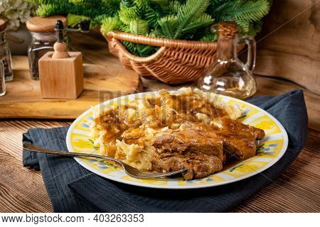 Delicious Pork Ribs Stewed In Gravy With Sauerkraut And Potatoes.