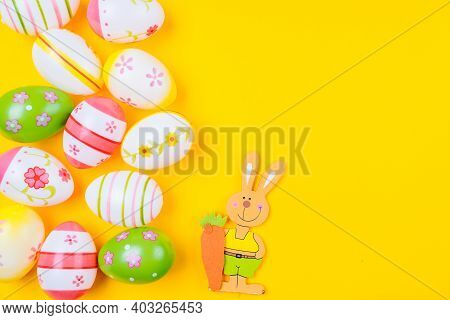 Colorful Easter Painted Eggs Background On Yellow Pastel Color Background With Space. Easter Holiday
