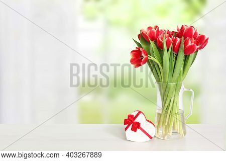 Happy Valentine Or Mothers Day Background. Beautiful Red Tulips And A Gift Box In Shape Of A Heart O