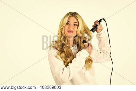 Girl With Gorgeous Healthy Smooth Hair Using Curler For Perfect Curls. Girl Care About Hairstyle. Fa