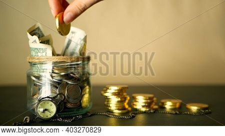 Saving Money Coin In Jar. Symbol Of Investing, Keeping Money Concept. Collecting Cash Banknotes In G