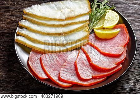 Smoked Fish Appetizer Plate: Cold Smoked Halibut And Cold Smoked Tuna Slices Served On A Black Plate