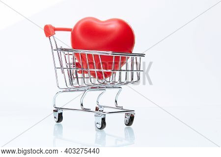 Red Heart In The Shopping Cart. Photo With A Copy-space.