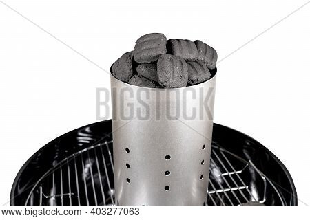 Charcoal Briquette In The Starter On The Grill Grid