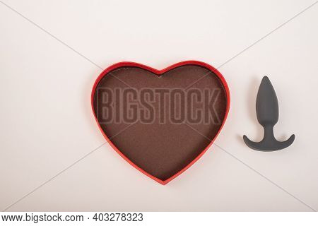 Heart-shaped Box And Butt Plug On A White Background. Love On February 14.