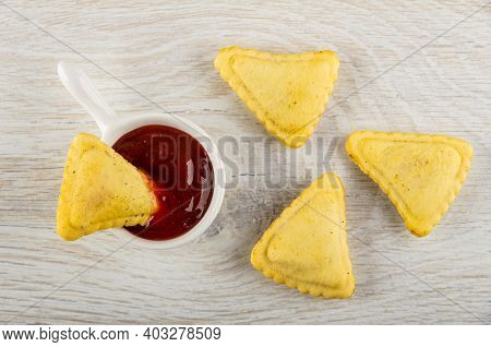 Small Pie In Sauce Boat With Ketchup, Few Savory Pies On Wooden Table. Top View