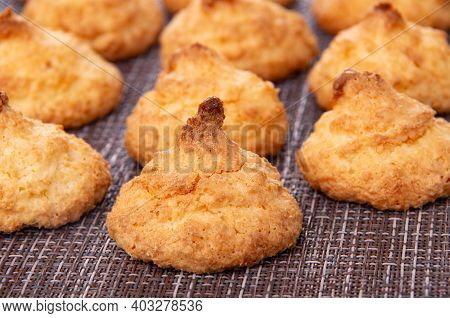 Close Up Of Coconut Cookies On Dark Mat