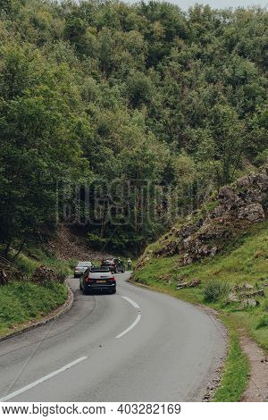 Cheddar Gorge, Uk - July 26, 2020: Cars On A Road Going Through Cheddar Gorge, A Famous Limestone Go