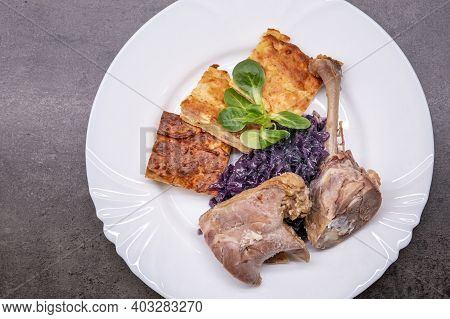 Roasted Duck Leg With Red Cabbage And Potato Pancake, Light Version. Healthy Eating