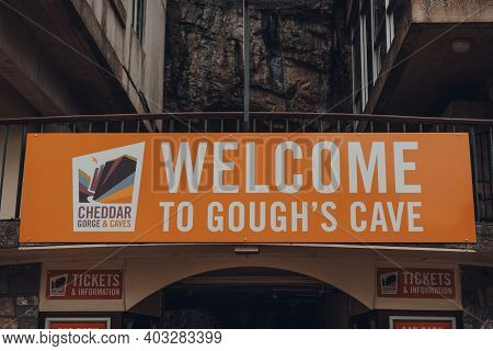 Cheddar, Uk - July 26, 2020: Close Up Of Welcome Sign Outside The Goughs Cave In Cheddar, A Village