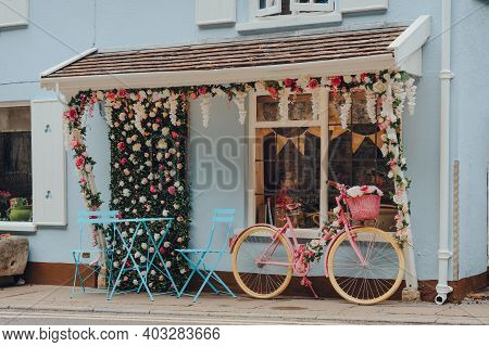 Cheddar, Uk - July 26, 2020: Pink Bike Parked By Pastel Coloured The Lion Rock Team Room In Cheddar,