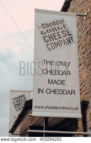 Cheddar, Uk - July 26, 2020: Sign Outside The Cheddar Gorge Cheese Company Shop In Cheddar, A Villag