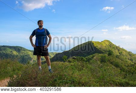 Man Trekker On Mountain Landscape Background. Summer Countryside Hiking Trail View With Male Tourist