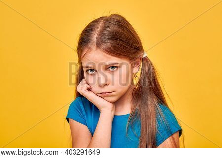 Beautiful Girl Has A Toothache And She Is Very Upset And Holding Her Cheek. Treatment Of Caries And