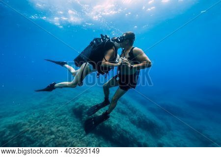 August 20, 2020. Anapa, Russia. Couple Of Scuba Divers Kiss Underwater In Transparent Blue Sea. Scub