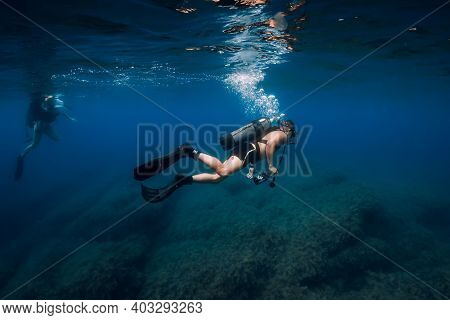 August 20, 2020. Anapa, Russia. Scuba Diver Swim Underwater In Transparent Blue Sea. Scuba Diving In