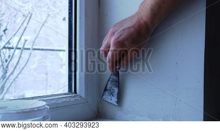Filling The Window Slope With Elastic Plaster Using A Narrow Trowel Close-up, Finishing The Slope Af