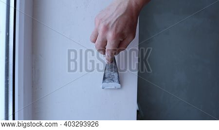 Detailed Finishing Work With A Narrow Spatula On The Surface Of The Window Slope, Construction Work