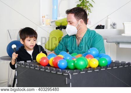 Child With Cerebral Palsy On Physiotherapy In A Children Therapy Center. Boy With Disability Doing E