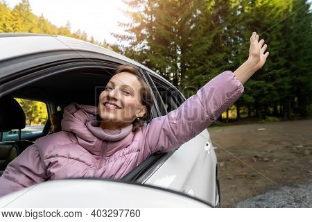 Portrait Of Young Adult Beautiful Caucasian Woman Driver Enjoy Roadtrip Adventure Traveling By Car O