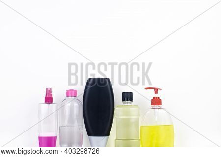 Isolated Bottles Of Detergents On A White Background. The Hand Takes The Jars Of Detergents. In The