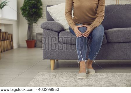 Woman With Rheumatic Disorder Or Knee Injury Feeling Intense Pain In Her Kneecap