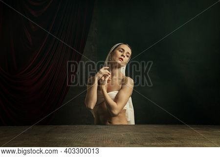 Inspiration. Modern Remake Of Classical Artwork - Young Medieval Woman In White Cloth On Dark Studio