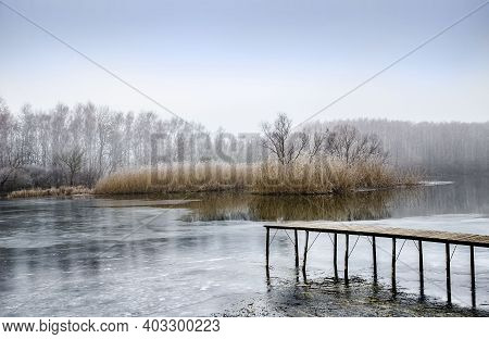 Landscape With Frozen Water, Ice And Fog On The River Seversky Donets Ukraine Cold Foggy Day