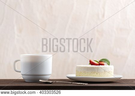 Cheesecake And Coffee On Wooden Table. Breakfast In Bed
