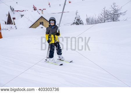 A Boy Lifting On The Ski Drag Lift Rope In Bright Sport Outfit On The Ski Resort Mountain Do A Ski L