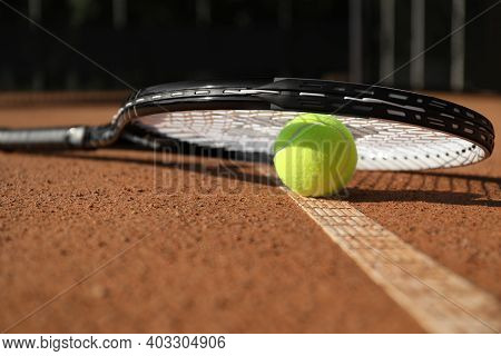 Tennis Ball And Racket On Clay Court, Closeup