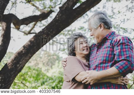 Happy Senior Couple Grandfather And Grandmother Embracing Each Other With Love And Smiley Faces Unde