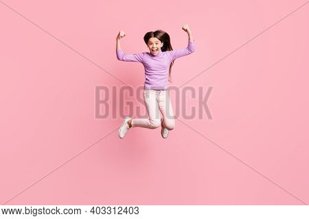 Full Length Photo Of Crazy Small Kid Girl Jump Show Triceps Hands Wear Purple Sweater Trousers Isola