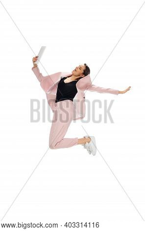 Flying. Happy Young Woman Dancing In Casual Clothes Or Suit, Remaking Legendary Moves And Dances Of