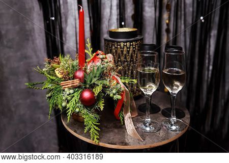 Luxury Romantic Candlelight Dinner Table Setup For Couple With Beautiful Light As Background. Two Gl