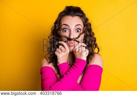 Photo Portrait Of Goofy Girl Making Hair Mustache Pouting Holding With Two Hands Wearing Casual Pink